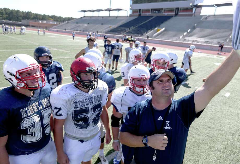 Barry Campbell, head football coach for Kingwood High School, from right, holds up notes for Zach Patterson, John Vincent and Michael Mark at practice at Turner Stadium on Sept. 7, 2017, in Humble. Photo: Jon Shapley, Staff / Houston Chronicle / © 2017 Houston Chronicle