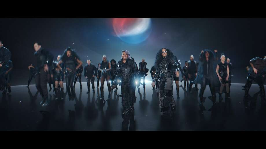 Missy Elliott (center left) and H.E.R. will be part of Pepsi's Super Bowl ad as the company tries to reignite the cola wars. Below: Ellen DeGeneres (left) and wife Portia De Rossi appear in a scene from Amazon's 2020 Super Bowl spot, touting Alexa. Photo: PepsiCo