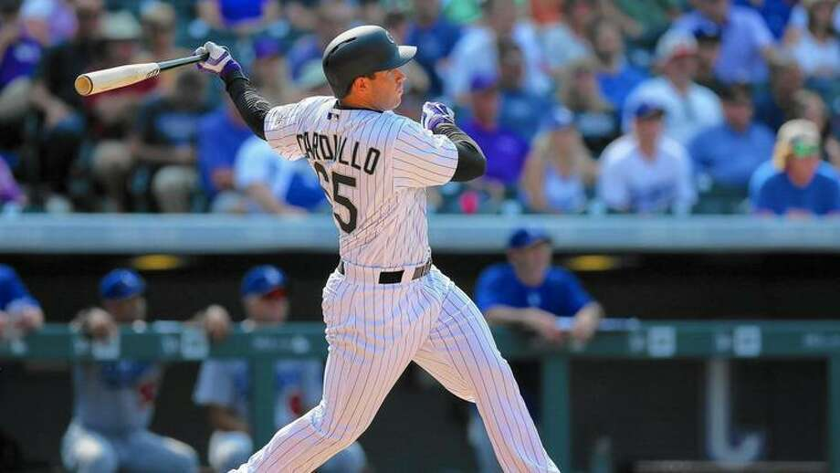 Stephen Cardullo watches his first career major league home run against the Dodgers at Coors Field on Aug. 31, 2016. Photo: Justin Edmonds /Getty Images