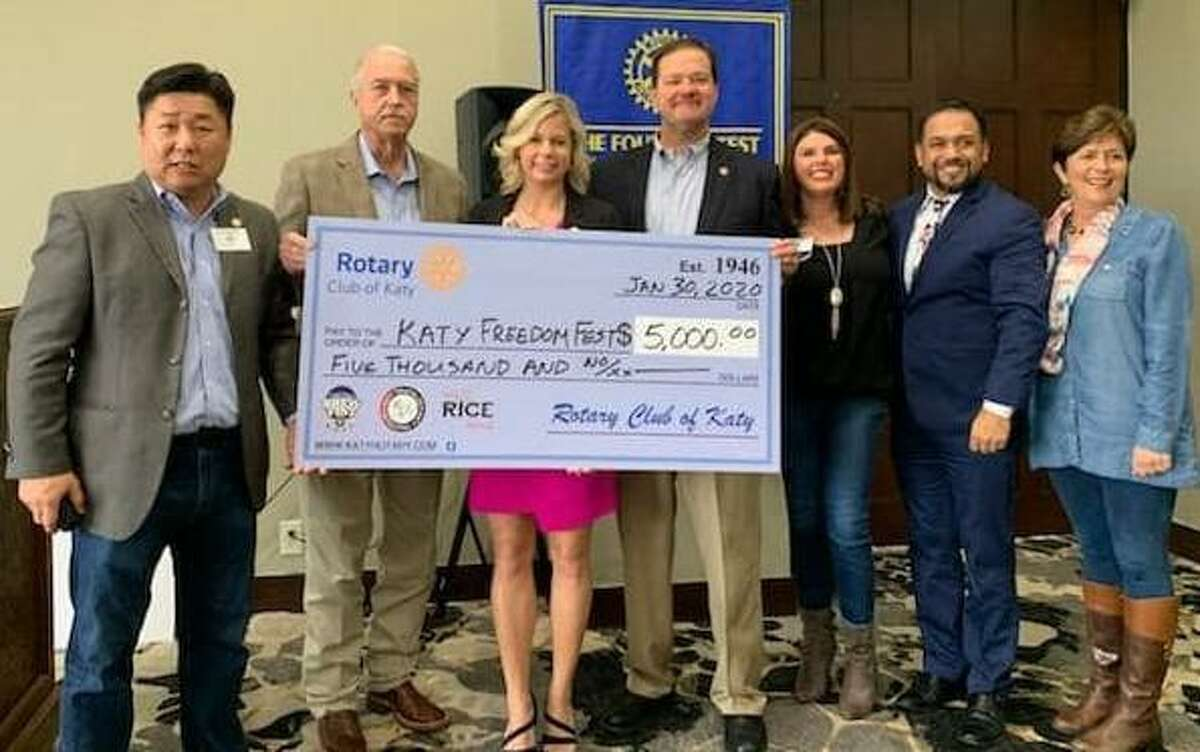 The Rotary Club of Katy presented a check to city officials for their Freedom Fest. From left are Scotty Jung, Bill Hastings, Kayce Reina, Byron Herbert, Heather Schuren, Eric San Miguel and Julie Sawyer