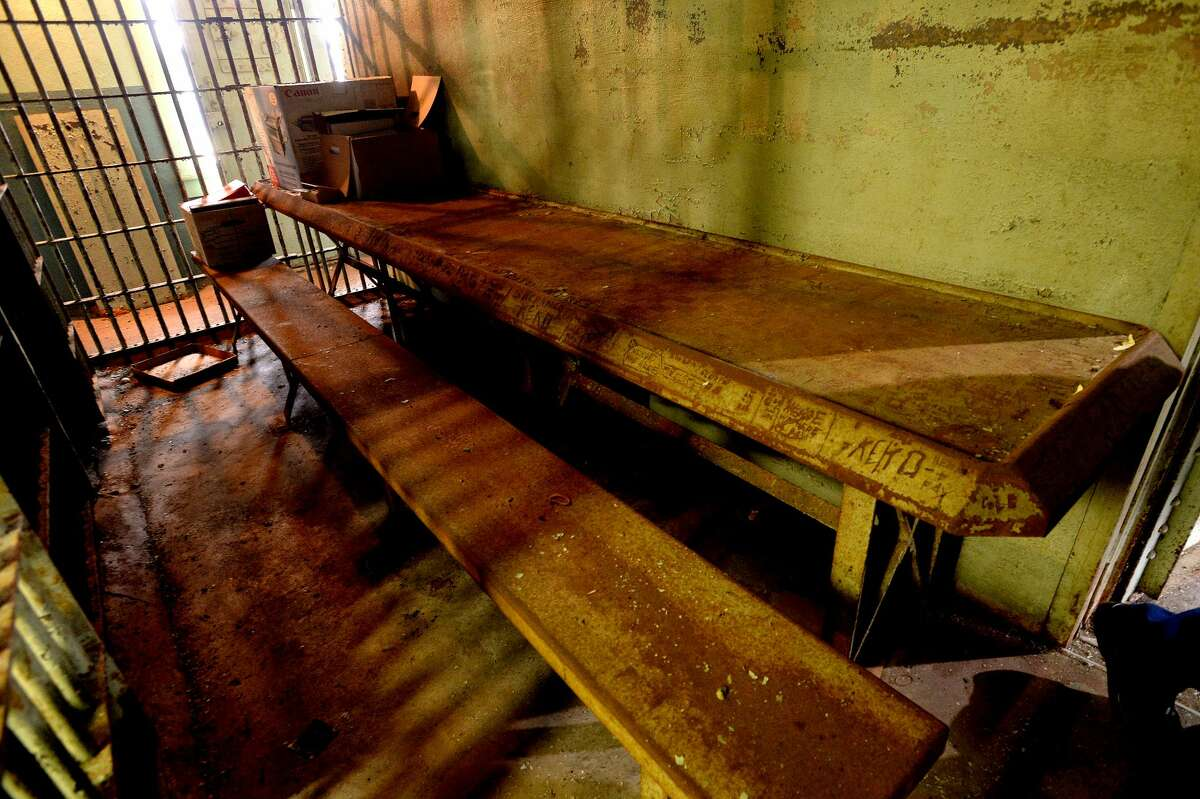 A narrow metal table sits outside the holding cells at the old Orange City Jail, located in what was once the carriage house of the Brown family home on Green Avenue. The house was later the home of city hall. Photo taken Monday, Jan. 27, 2020 Kim Brent/The Enterprise