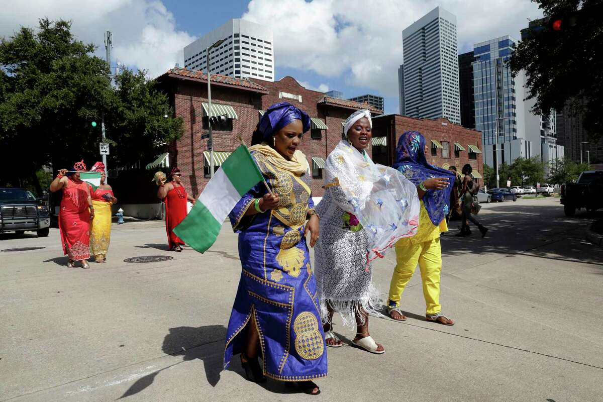 Parade participants in traditional attire during the Nigerian Cultural Festival held at in downtown Houston in September 2019. The metropolitan area is home to 35,000 Nigerians, the biggest population in the country after the New York- Newark- Jersey City area.