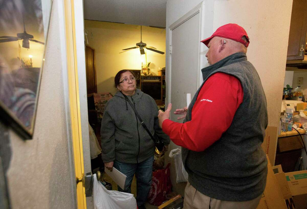 Homeowner Angeline Garza, 65, and State Farm Homeowners Claims Team Manager Dean Crane go over her insurance coverage of her house, personal properties and pets Wednesday, Jan. 29, 2020, at her damaged house in Houston. Garza's home, located on Stanford Court, was damaged in the Watson Grinding & Manufacturing explosion last week. Garza, her 41-year-old daughter and her two grandchildren will have to move to an apartment temporarily.