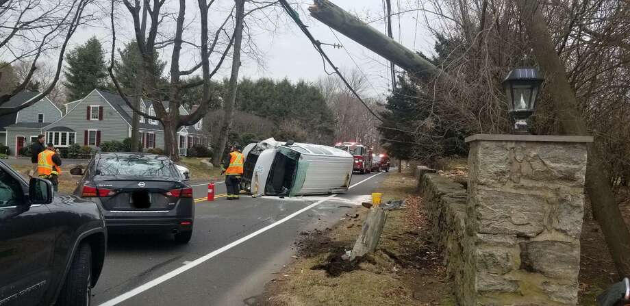 Westport, Conn., first responders on scene of a rollover crash that damaged a utility pole Friday, Jan. 31, 2020. Any edits to the photo were not made by Hearst Connecticut Media. Photo: Contributed Photo / Westport Fire Department