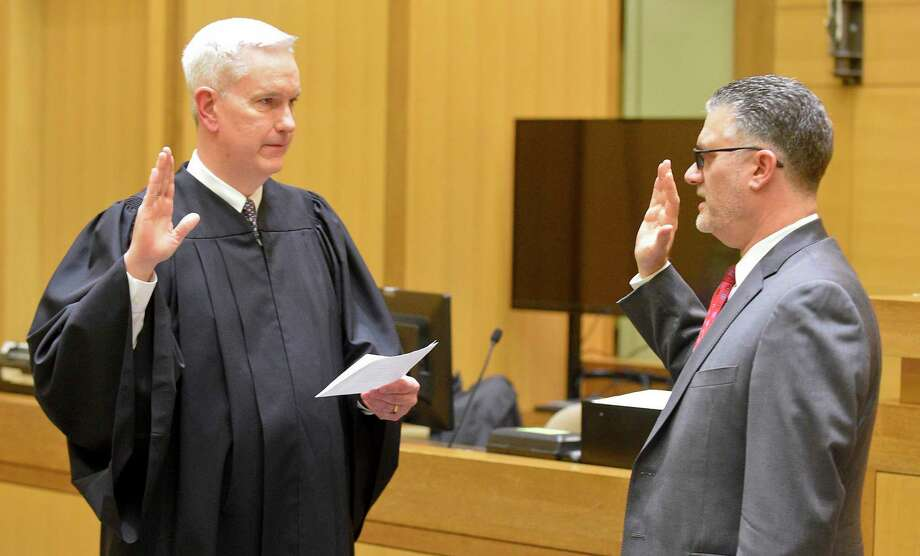 Richard Colangelo Jr. is sworn in as Connecticut chief state's attorney by Justice Andrew McDonald, left, before hundreds of colleagues, family and friends at Stamford's Superior Courthouse on Jan. 31. Photo: Matthew Brown / Hearst Connecticut Media / Stamford Advocate