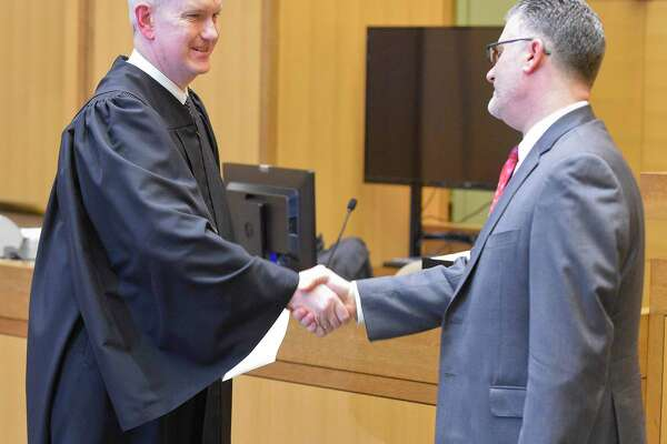 Richard Colangelo Jr. is sworn in as Connecticut chief state's attorney by Justice Andrew McDonald before hundreds of colleagues, family and friends at Stamford's Superior Courthouse on Jan. 31, 2020. Colangelo, who has served as state's attorney for the Stamford and Norwalk Judicial District since July 2015, will begin serving as Chief State's Attorney immediately to complete the term of former Chief State's Attorney Kevin Kane who retired in November. Colangelo will then have to be re-appointed to another term.
