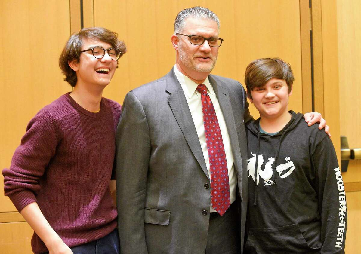 Richard Colangelo Jr. is photograph with his sons Jake and Zachary, after being sworn in as Connecticut chief state's attorney by Justice Andrew McDonald before hundreds of colleagues, family and friends at Stamford's Superior Courthouse on Jan. 31, 2020. Colangelo, who has served as state's attorney for the Stamford and Norwalk Judicial District since July 2015, will begin serving as Chief State's Attorney immediately to complete the term of former Chief State's Attorney Kevin Kane who retired in November. Colangelo will then have to be re-appointed to another term.