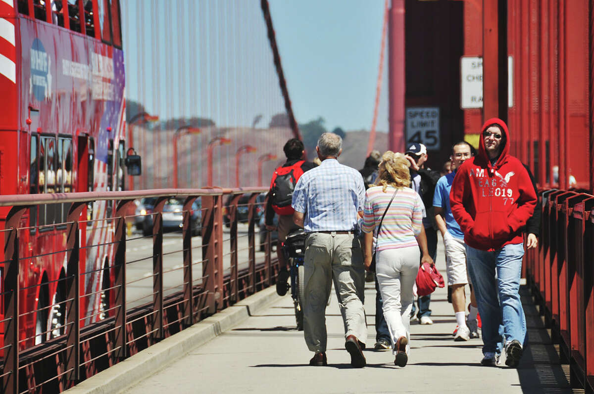 Now: Golden Gate Bridge The Golden Gate Bridge attracts tourists who want to walk along it or pass through it on tour bus, like the one pictured here.In 2018, the Golden Gate National Parks said that the iconic bridge attracts more than 15 million visitors each year.