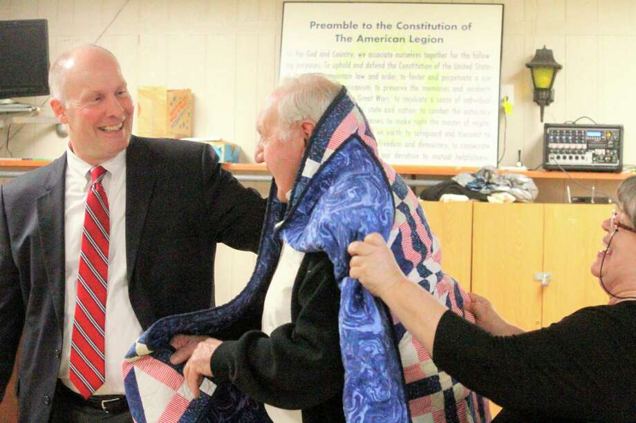 During Moolenaar's visit,Stanwood Veteran Lester Ellisonwas presented with a quilt from the Quilts of Valor Foundation. (Pioneer photo/Catherine Sweeney)