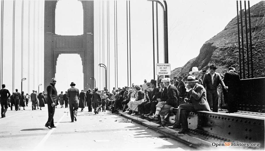 """Then: Golden Gate Bridge Tons of people turned out for """"Pedestrian Day"""" pictured here on May 27, 1937. The day marked the first time pedestrians were allowed to walk across the bridge since its completion that same year. Photo: OpenSFHistory / Wnp37.02015.jpg"""