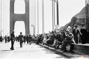 "Then: Golden Gate Bridge     Tons of people turned out for ""Pedestrian Day"" pictured here on May 27, 1937. The day marked the first time pedestrians were allowed to walk across the bridge since its completion that same year."