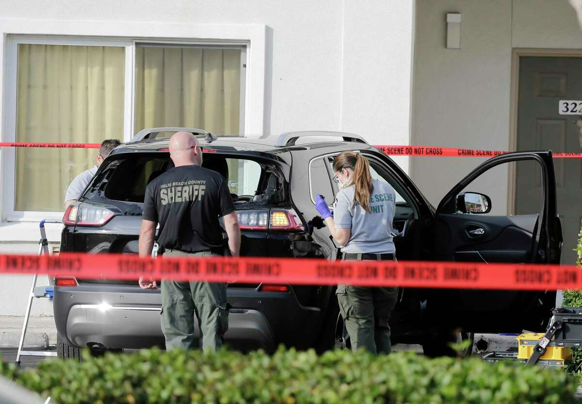 Forensic technicians work on the vehicle authorities say officers fired shots at, that breached security at President Donald Trump's Mar-a-Lago resort in Palm Beach, Friday, Jan. 31, 2020, in West Palm Beach, Fla.