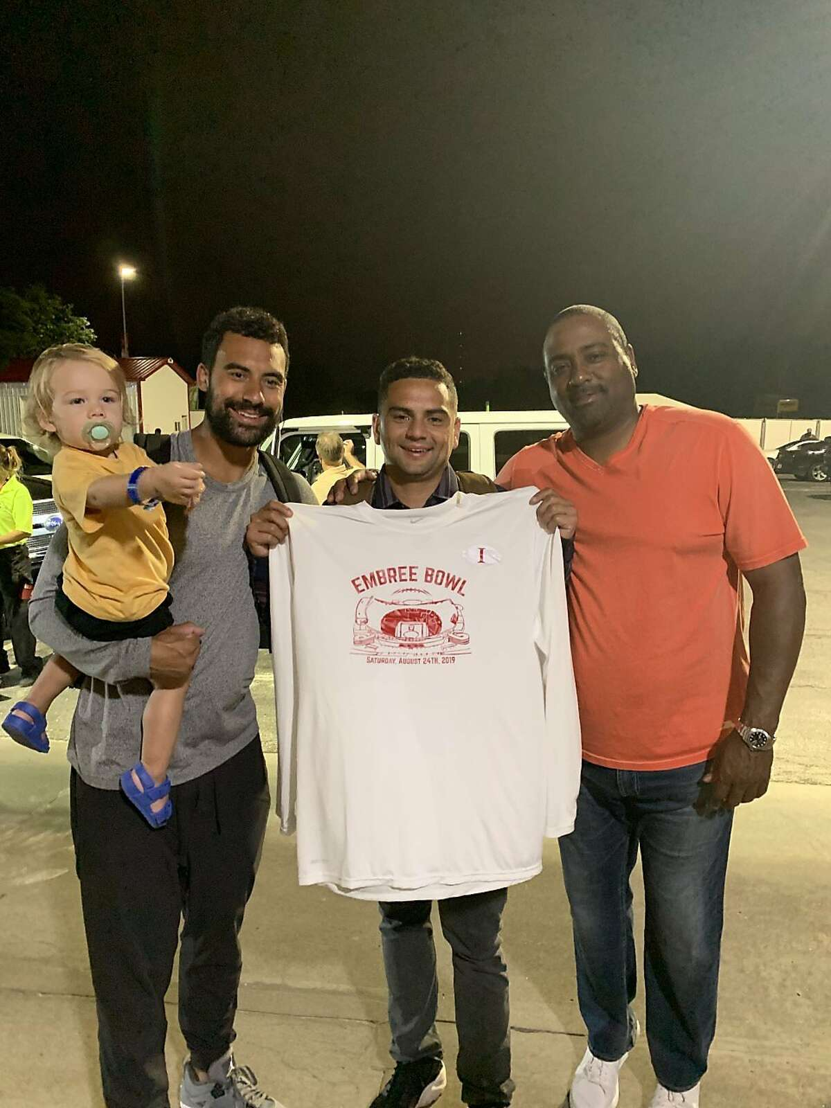 (From left to right) Taylor Embree, Connor Embree and Jon Embree after the 49ers' preseason win over the Chiefs in August in Kansas City. Taylor Embree is holding his 2-year-old son, Grayson.