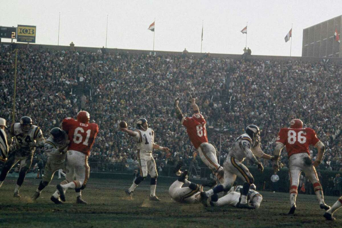 NEW ORLEANS - JANUARY 11: Minnesota Vikings' quarterback Joe Kapp #11 passes against the Kansas City Chiefs during Super Bowl IV at Tulane Stadium on January 11, 1970 in New Orleans, Louisiana. The Chiefs defeated the Vikings 23-7. (Photo by Focus on Sport/Getty Images)