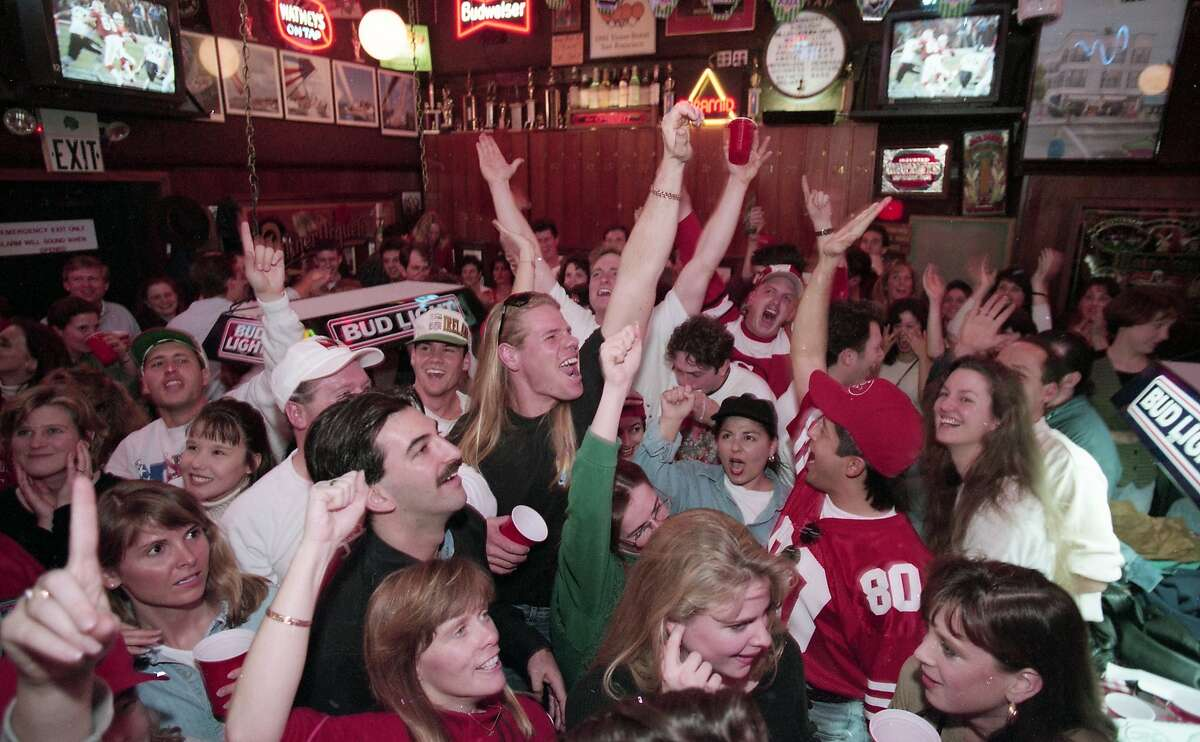 Fans back in the Bay Area celebrate as the 49ers beat the San Diego Chargers 49-26 to win Super Bowl XXIX, January 29, 1995