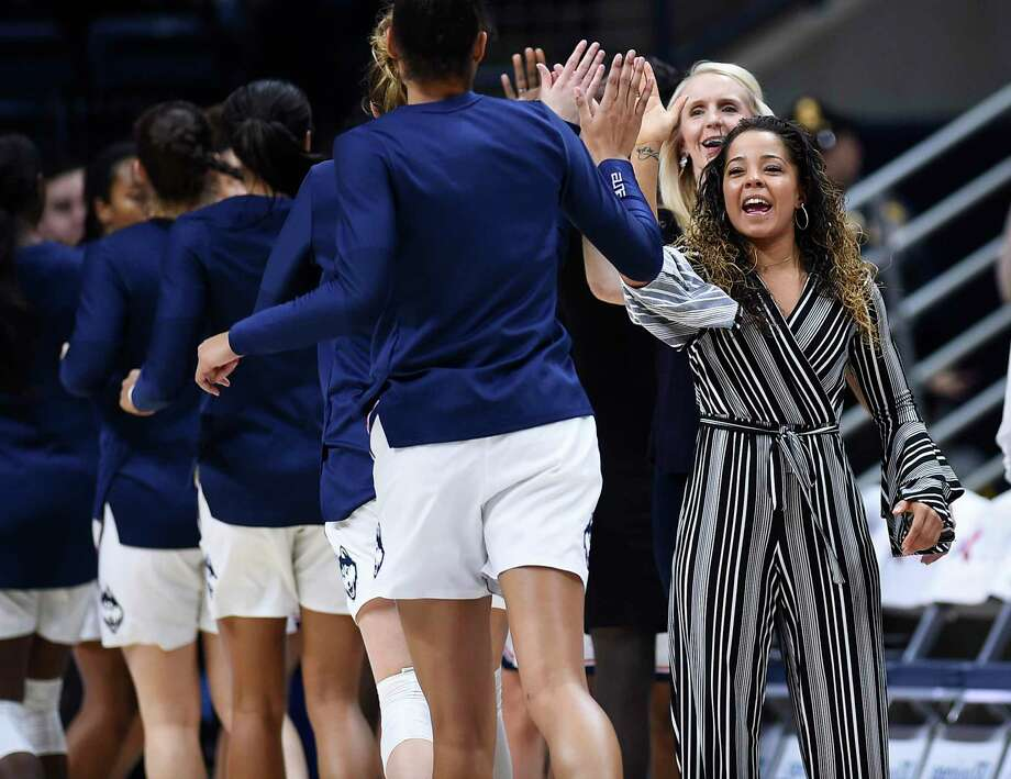 Connecticut assistant coach Jasmine Lister, right greets players before an NCAA exhibition women's college basketball game in Storrs, Conn., Sunday, Nov. 4, 2018. (AP Photo/Jessica Hill) Photo: Jessica Hill / AP / Copyright 2018 The Associated Press. All rights reserved