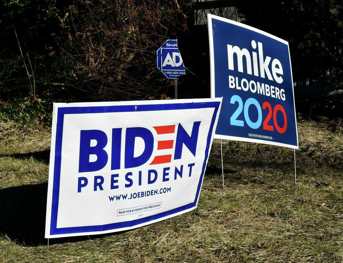 A house on Livingston Street in New Haven has dueling lawn signs supporting candidates in the Democratic presidential race.