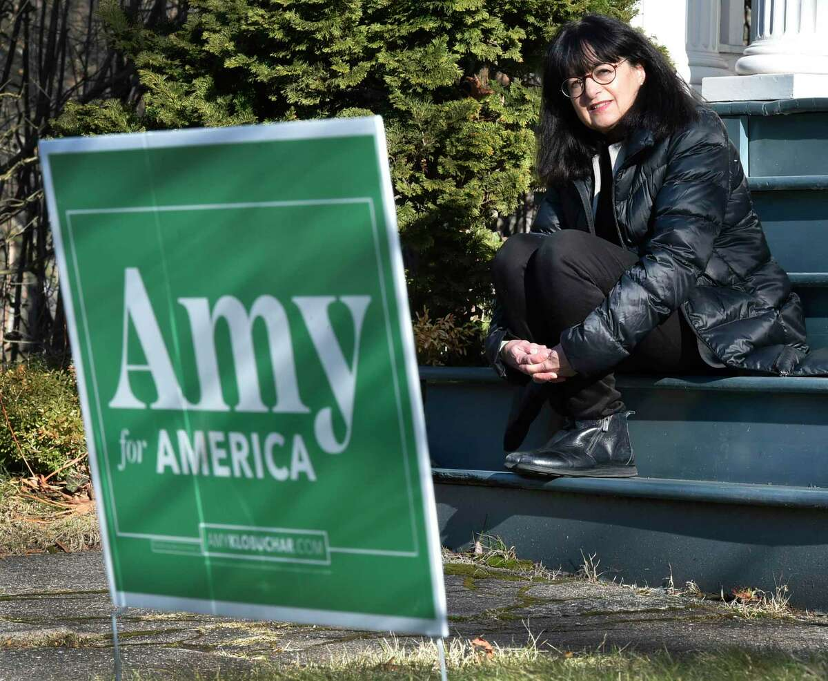 Linda Lindroth with a campaign sign for Minnesota Sen. Amy Klobuchar in front of her Livingston Street home in New Haven.