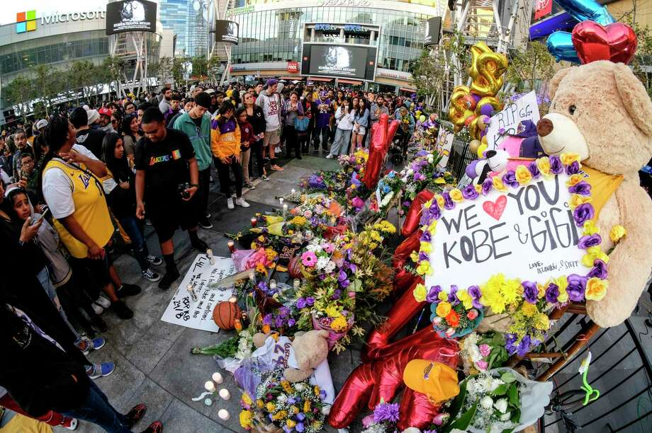 People gather at a memorial for Kobe Bryant near Staples Center last week in Los Angeles. A reader focuses on the teenagers who perished in the helicopter crash. Photo: Ringo H.W. Chiu / Associated Press / Copyright 2020 Associated Press. All rights reserved.