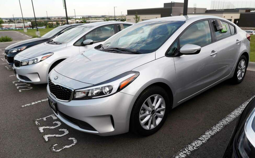 FILE - In this June 26, 2018, file photo a used 2017 Kia Forte sits in a row of other used, late-model sedans at a dealership in Centennial, Colo. Consumers bought an estimated 40.4 million used vehicles last year, likely passing the old record of 40.2 million set in 2018, according to figures from the Edmunds.com auto pricing site. (AP Photo/David Zalubowski, File)