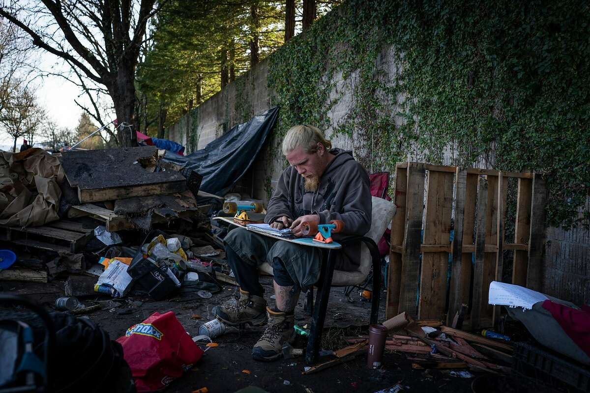 Steve Floyd, 33, writes a note to his mom before being forced to move from his home on the Joe Rodota Trail in Santa Rosa, California on January 31st, 2020.