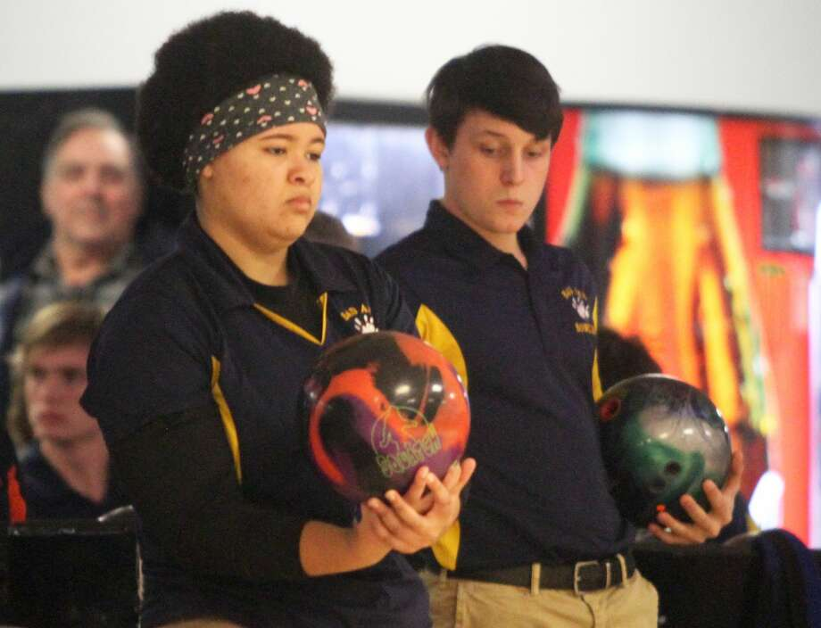 Both the Bad Axe boys and girls bowling teams produced clear victories at Longshot Lanes on Thursday when the boys squad logged a 22-8 win over Cass City followed by the girls, who picked up another 29-1 at the match. Photo: Tribune File Photo