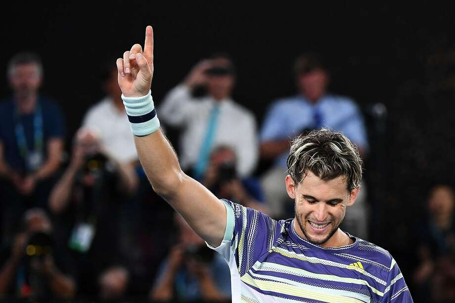 TOPSHOT - Austria's Dominic Thiem celebrates after victory against Germany's Alexander Zverev during their men's singles semi-final match on day twelve of the Australian Open tennis tournament in Melbourne on January 31, 2020. (Photo by William WEST / AFP) / IMAGE RESTRICTED TO EDITORIAL USE - STRICTLY NO COMMERCIAL USE (Photo by WILLIAM WEST/AFP via Getty Images) Photo: WILLIAM WEST / AFP Via Getty Images
