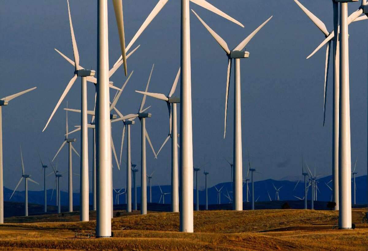 This May 6, 2013, file photo shows a wind turbine farm owned by PacifiCorp near Glenrock, Wyo. A group of Wyoming lawmakers is bucking the U.S. trend of supporting renewable energy with a plan to do the opposite: Fine utilities if they provide energy produced by wind or the sun.