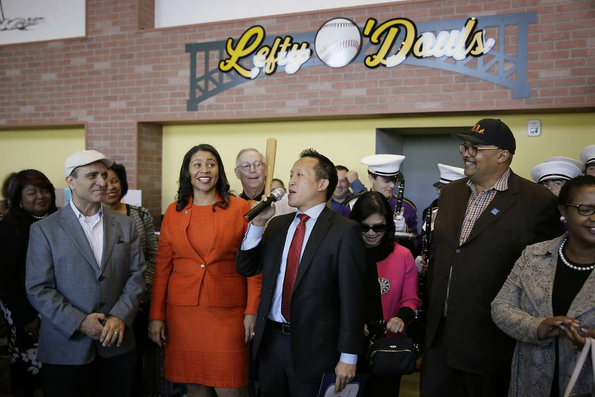FILE - In this Nov. 20, 2018, file photo, from left, owner Nick Bovis, San Francisco Mayor London Breed, state assemblyman David Chiu speaking and city public works director Mohammed Nuru take part in the opening ceremonies of Lefty O'Doul's Baseball Ballpark Buffet & Caf� at Fisherman's Wharf in San Francisco. A top San Francisco official in charge of cleaning up the city's notoriously filthy streets and a champion of adding more portable toilets has been arrested, jail records show. Nuru was taken into custody Monday, Jan. 27, 2020, along with Bovis, the owner of Lefty O'Doul's, a longtime sports bar popular with tourists. Records say only that the men were arrested for felony safekeeping, which typically indicates federal charges. (AP Photo/Eric Risberg)