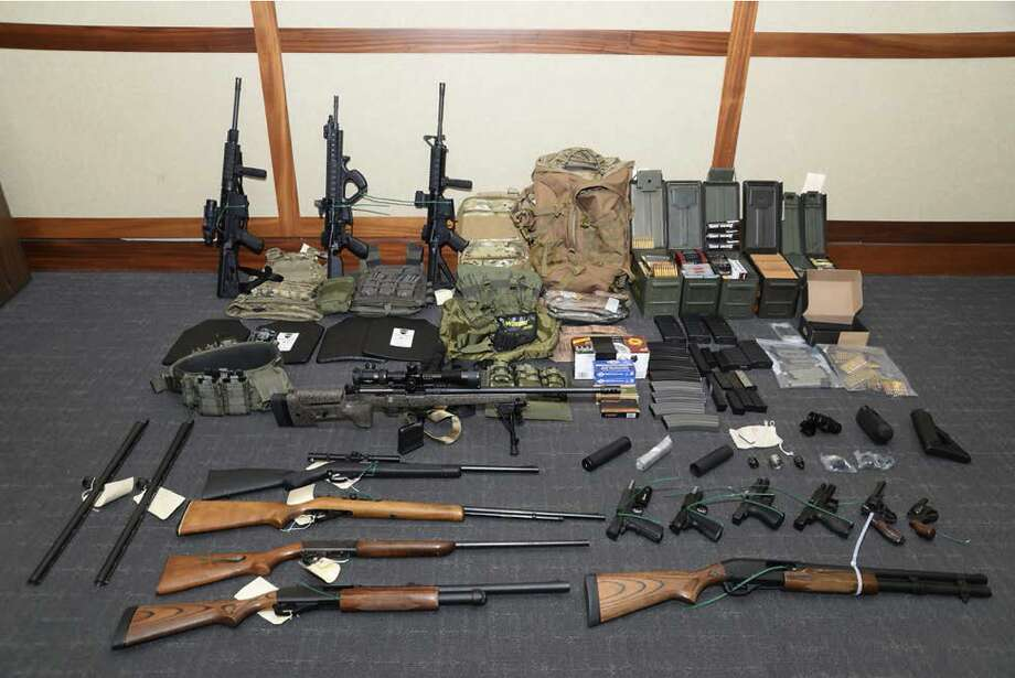 This undated file image provided by the Maryland U.S. District Attorney's Office shows a photo of firearms and ammunition that was in the motion for detention pending trial in the case against Christopher Hasson. The Coast Guard lieutenant accused of stockpiling guns and drawing up a hist list of prominent Democrats and TV journalists was sentenced on Friday. Photo: / Associated Press