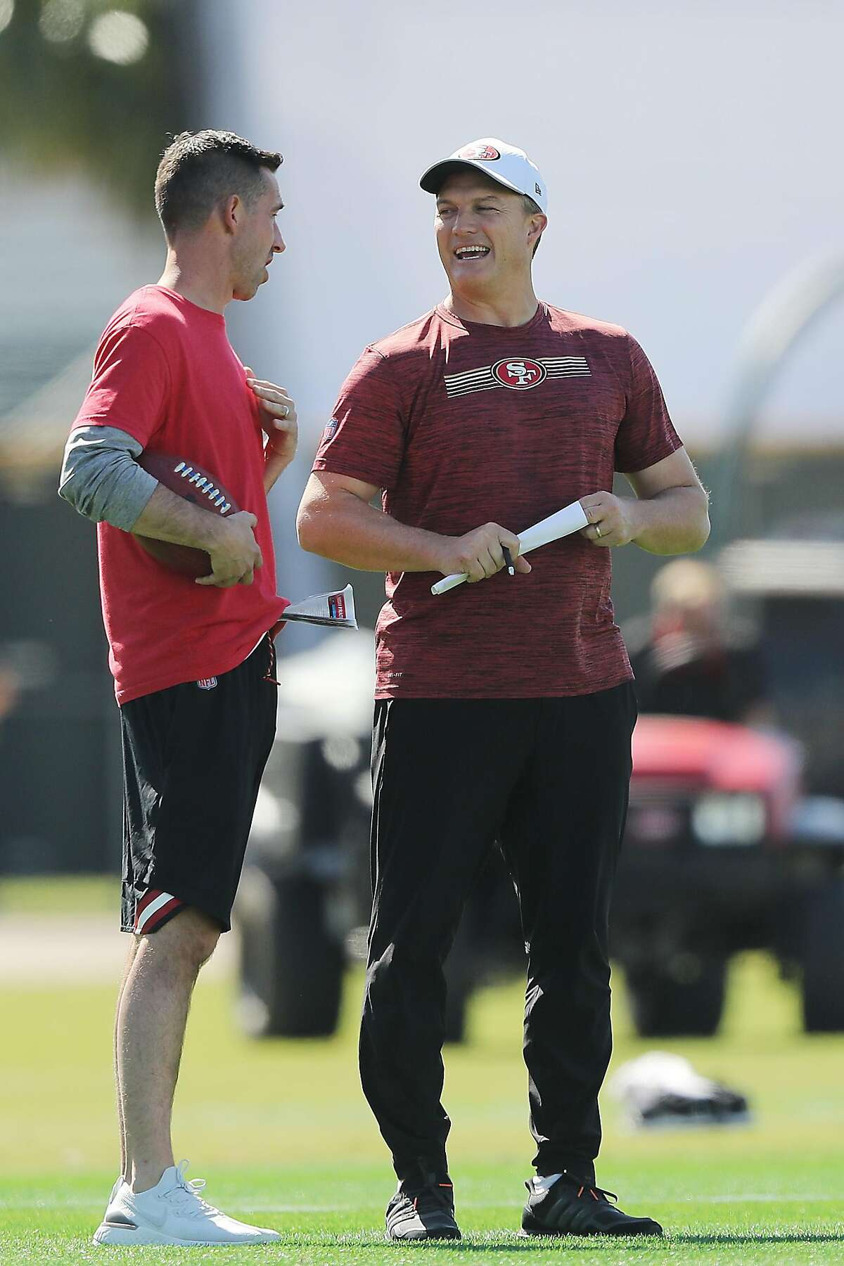 Head coach Kyle Shanahan of the San Francisco 49ers (L) talks with general manager John Lynch during practice for Super Bowl LIV at the Greentree Practice Fields on the campus of the University of Miami on January 30, 2020 in Coral Gables, Florida. (Photo by Michael Reaves/Getty Images)