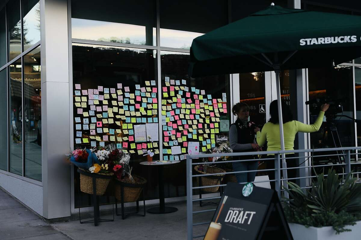 A multitude of post-it notes have been left in memory of a customer who two days prior was critically injured at Starbucks, located at 2080 Mountain Blvd., in Montclair, Calif., on Wednesday, January 2, 2020. On New Year's Eve, the man was critically injured outside the coffee shop after he chased the thief who stole his laptop. The man later died of his injuries as a result of the incident. The Oakland Police Department announced on New Year's Day that two men had been arrested in connection with Tuesday's episode.