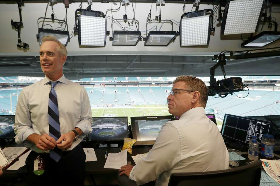 FILE - In this Aug. 23, 2019, file photo, Fox Sports play-by-play announcer Joe Buck, left, and analyst Troy Aikman, right, work in the broadcast booth before a preseason NFL football game between the Miami Dolphins and Jacksonville Jaguars in Miami Gardens, Fla. (AP Photo/Lynne Sladky, File) Photo: Lynne Sladky, Associated Press