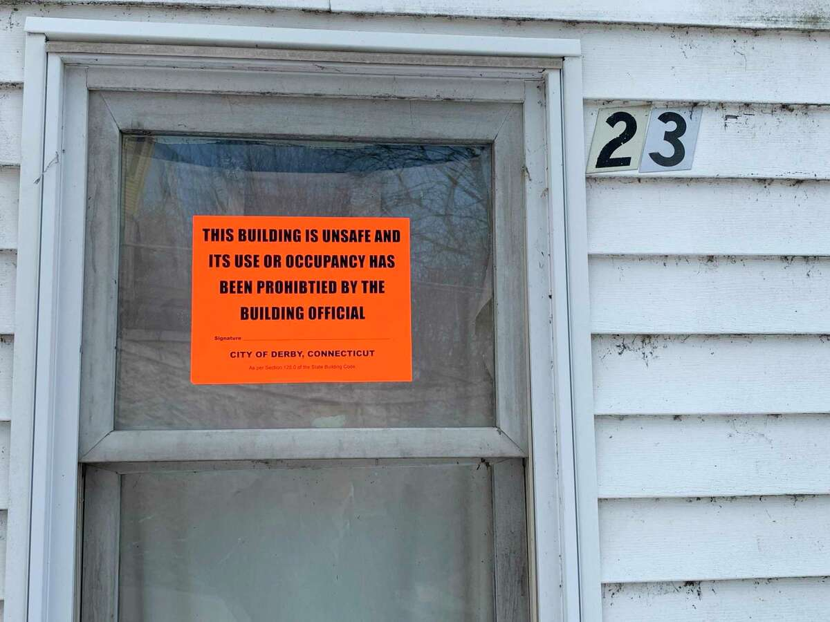 A condemnation sign placed on a multi- family home on Derby's Crescent Street informs the public the building is unsafe for occupancy.
