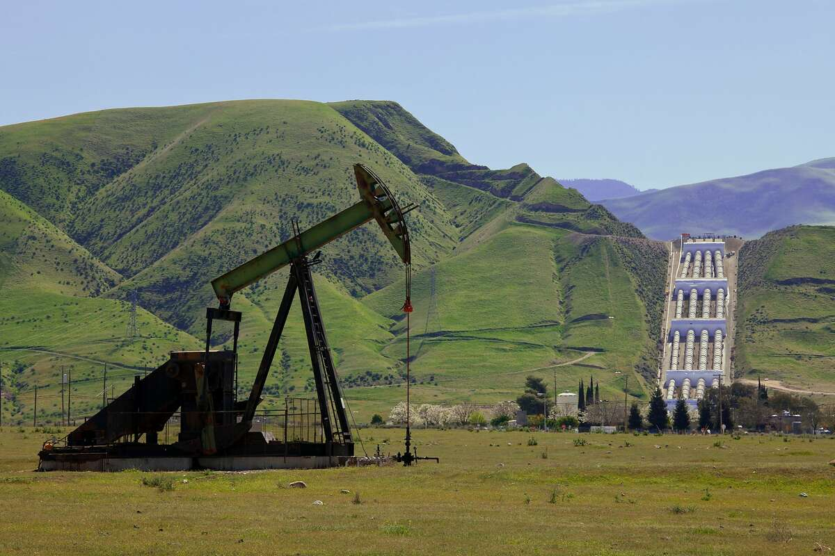 Oil Derricks near the Ira J. Chrisman Wind Gap Pumping Plant, part of the California State Water Project, is located at the southern end of the San Joaquin Valley. Water is pumped 518 feet over the Grapevine from the California Aqueduct, enroute to Los Angeles as part of its water supply. Kern County, California , USA. (Photo by: Citizens of the Planet/Education Images/UIG via Getty Images)