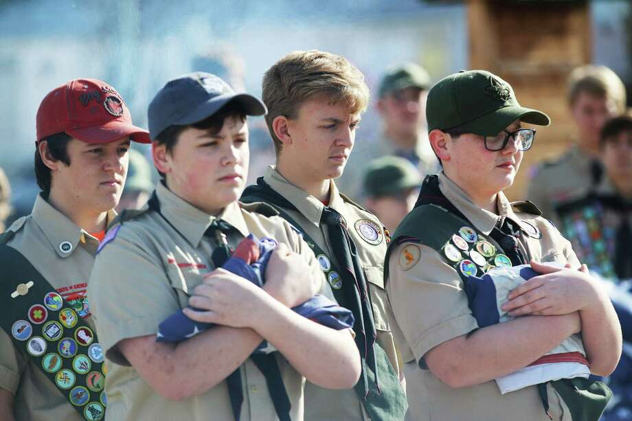 Honor Guard members from Troop 8 in Dayton prepare to post the U.S. and Texas flags for presentation to the crowd assembled for the flag retirement ceremony. Scouts are from left, Regan King, Alex Lewis, Sheridon Graves, and Lance Martin. Photo: David Taylor / Staff Photo