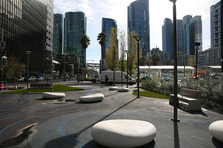 An urban park on the corner of Howard and Main streets in San Francisco is one of two oases that will give way to construction staging areas — if and when the rail extension eventually reaches the transit center. Photo: Lea Suzuki / The Chronicle