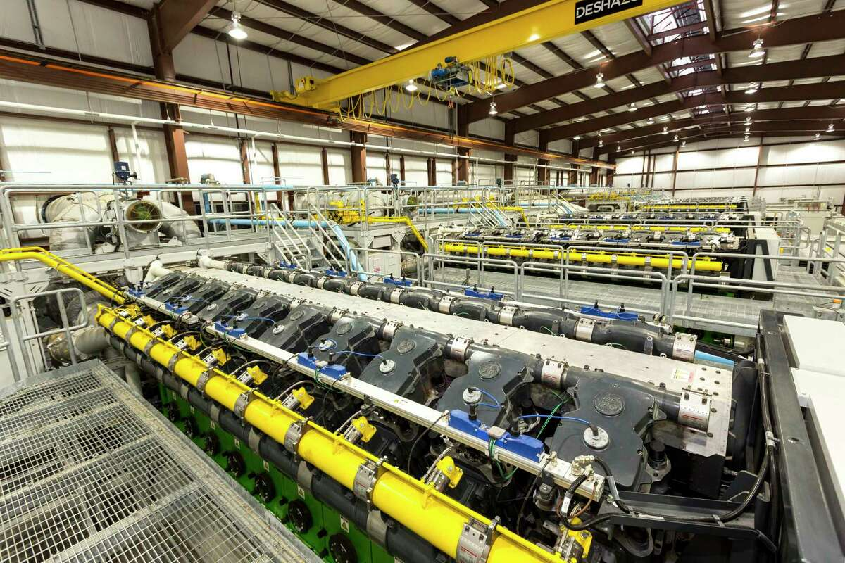 """The new Sky Global Power One power plant west of Houston in Rock Island uses new technology from General Electric that stacks together natural gas-fired generation sets. The project includes six of GE's """"J920 FleXtraultra-fast response"""" generator sets to make up the 51-megawatt power plant."""