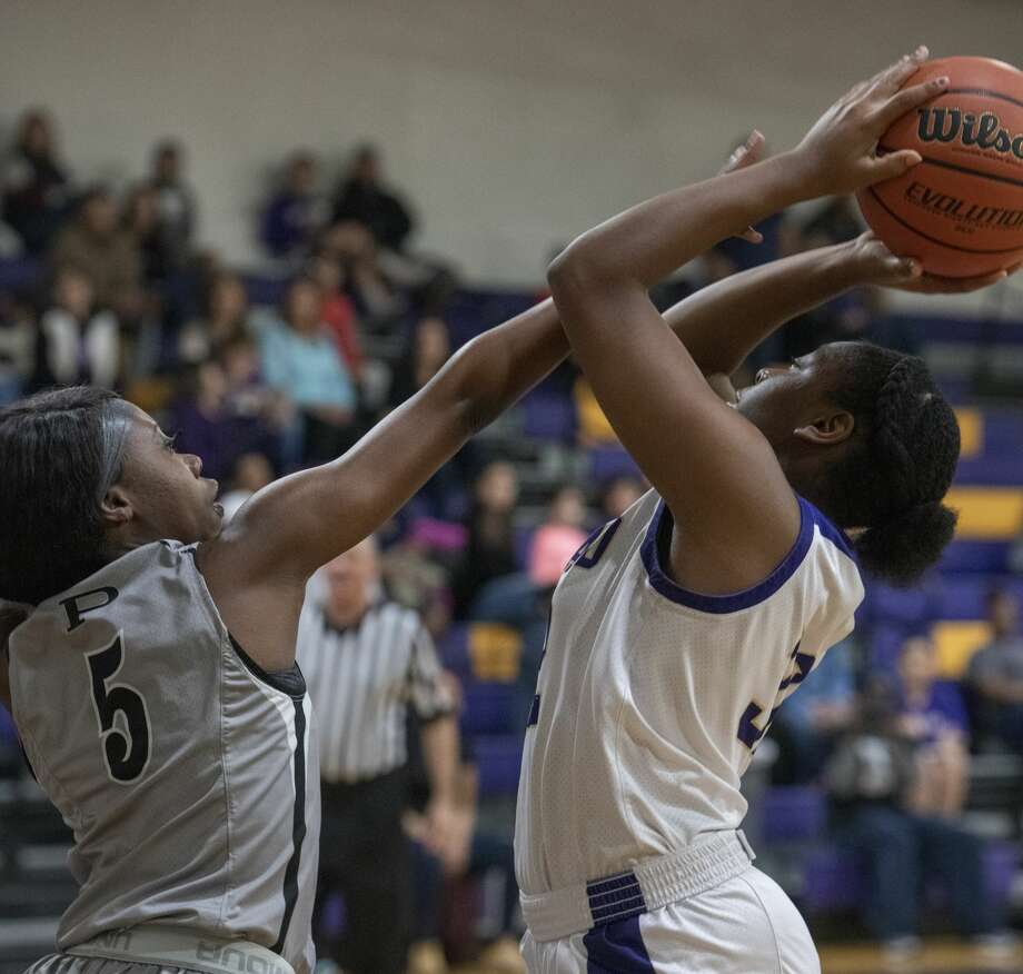 Midland High's Ty'Eisha Satterwhite goes up for a shot as Permian's Nodia Cooper defends 01/31/20 at the Midland High gym. Tim Fischer/Reporter-Telegram Photo: Tim Fischer/Midland Reporter-Telegram