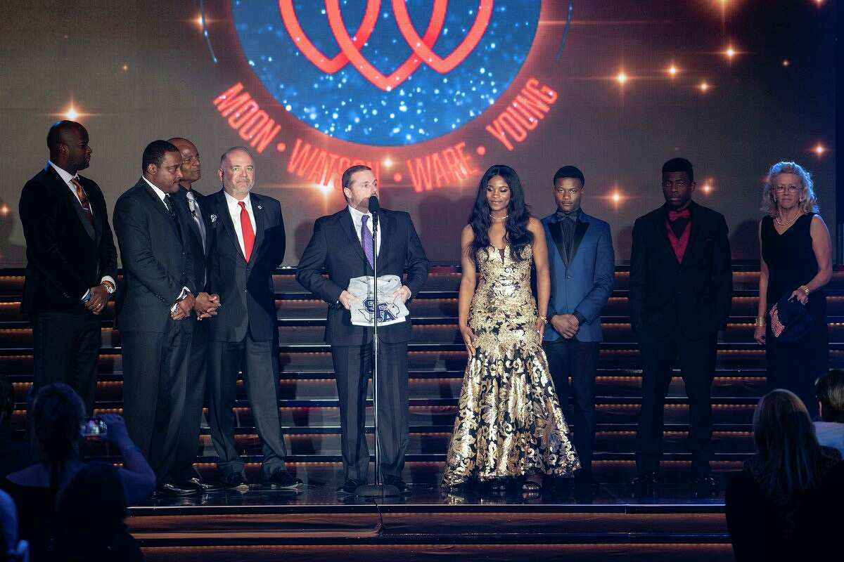 Vankey Burks receives the news she was accepted to SFA at the Houston Sports Awards recently as part of the Brothers in Arms program.