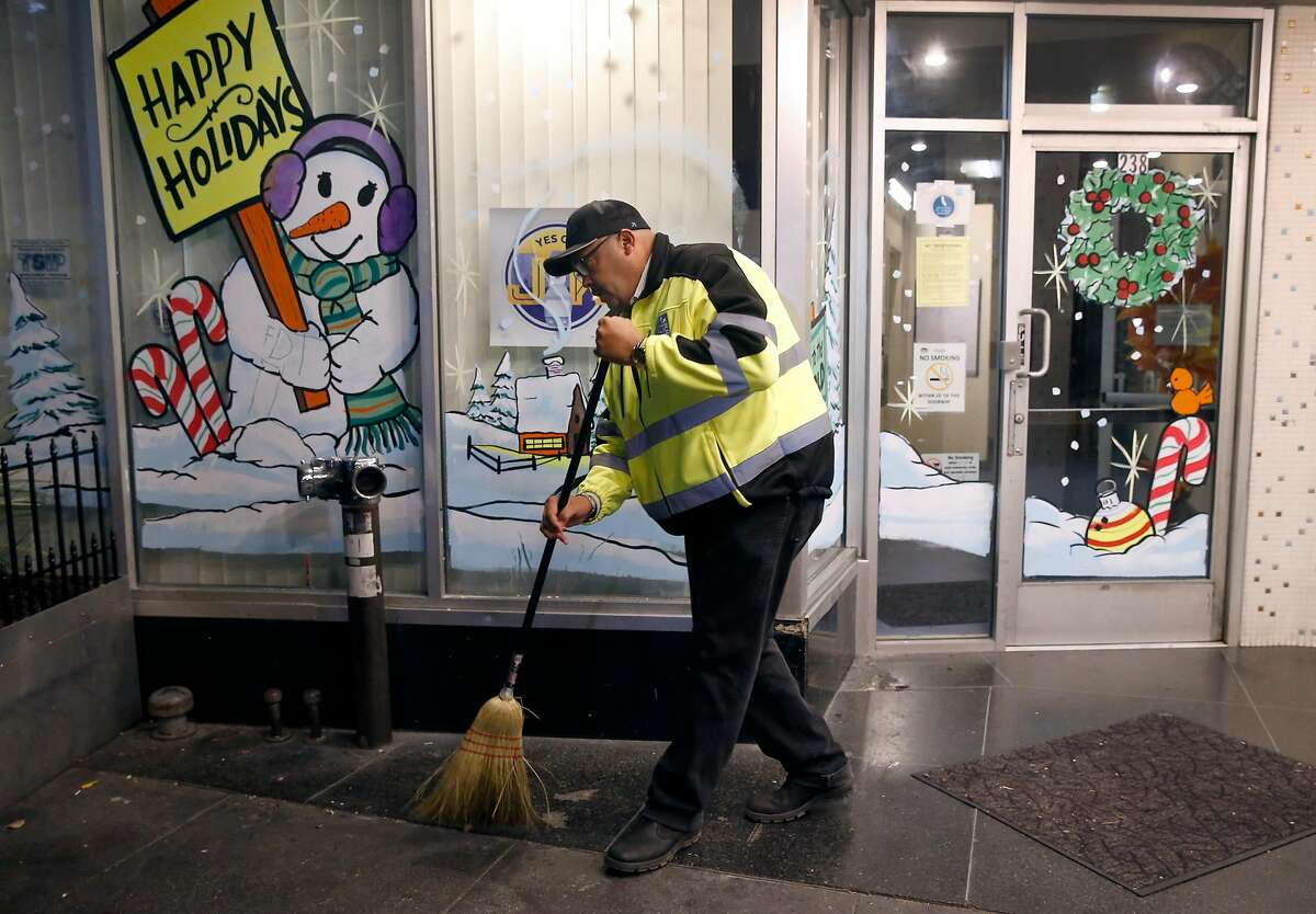 Director of Public Works Mohammed Nuru pitches in to help his department's TL Cares clean team pick up trash in the Tenderloin in San Francisco, Calif. on Wednesday, Dec. 7, 2016.