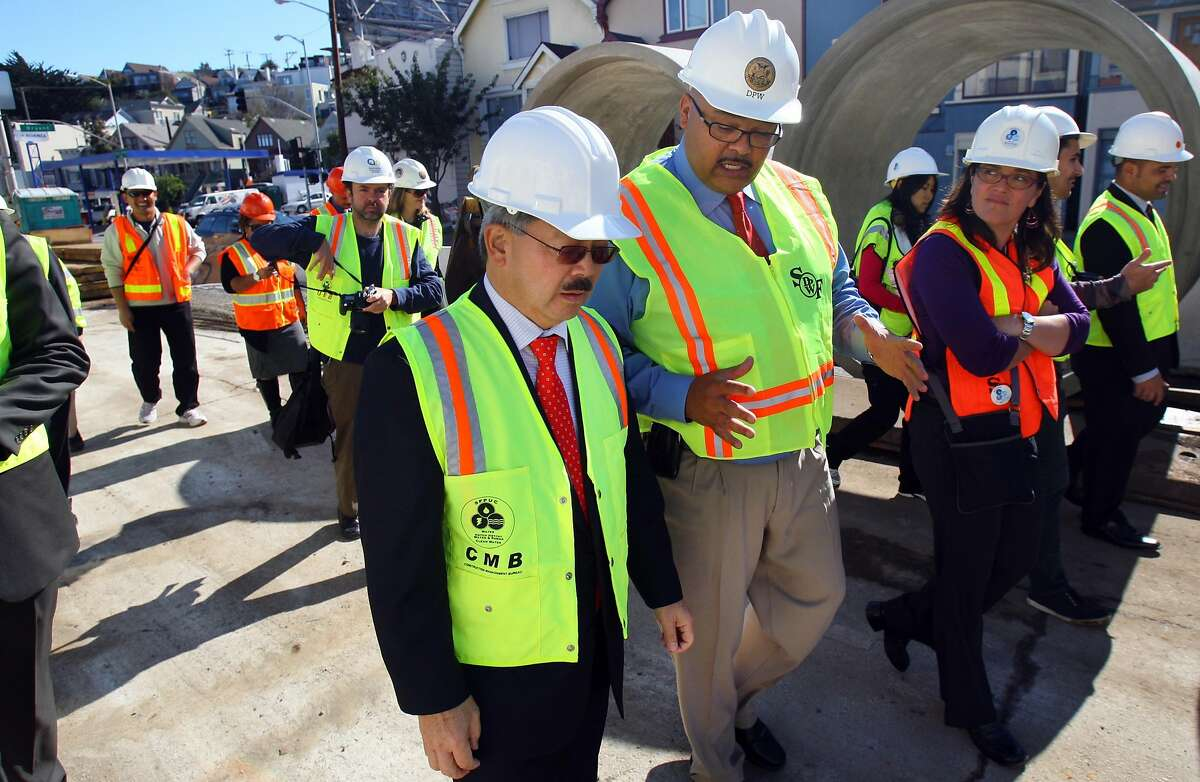 Mayor Ed Lee (left center) talks with Interim Head of the Department of Public Works, Mohammed Nuru (center right), at the construction site at Cesar Chavez and Florida St. in San Francisco, Calif., on Friday, Nov. 4, 2011.