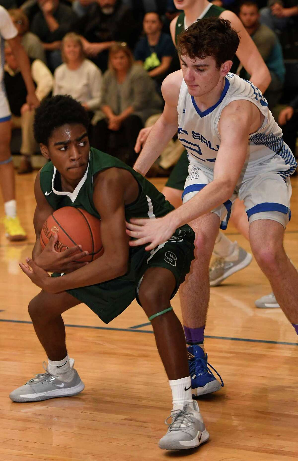 Schalmont's Trent Randle recovers the ball before LaSalle's Gabe Lucarelli during a game on Friday, Jan. 31, 2020, in Troy, N.Y. (Jenn March, Special to the Times Union )