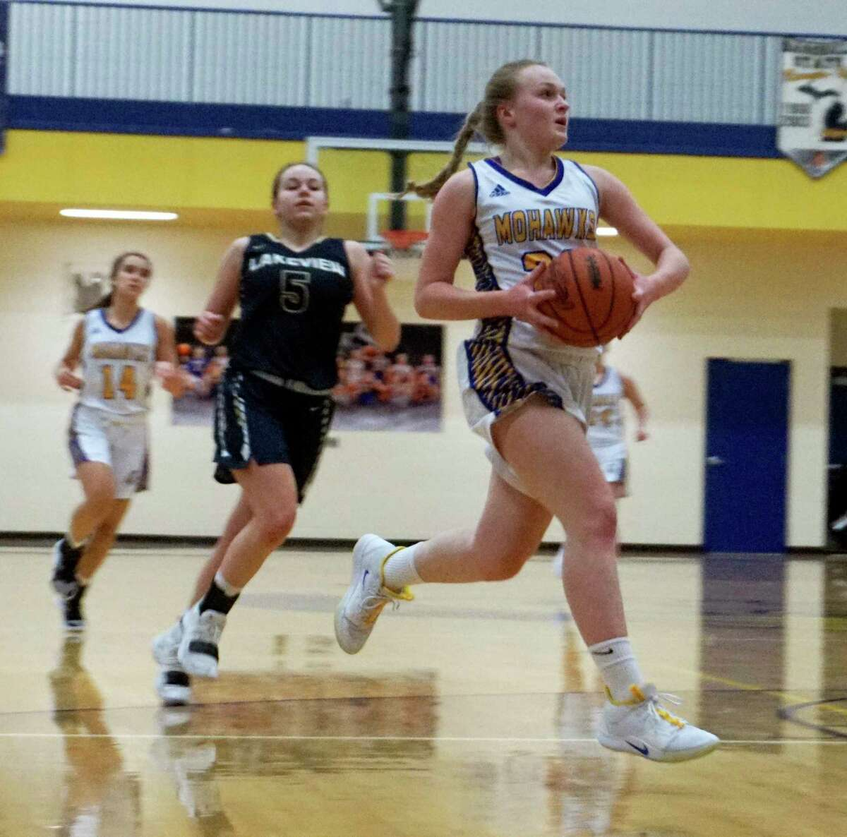 Mohawk sophomore Madison Garbow glides through the lane on the way to a layup during the MS girls' win over Lakeview on Friday night. (Pioneer photo/Joe Judd)