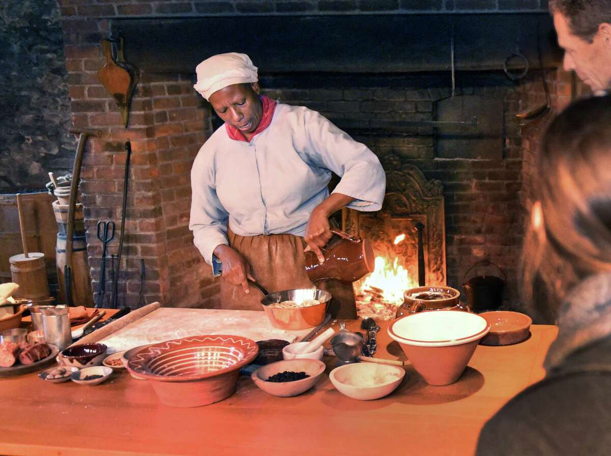 Lavada Nahon of Peekskill conducts a hearth cooking demonstration during the Pinkster celebration at Fort Crailo state historic site Saturday April 22, 2017 in Rensselaer, NY. (John Carl D'Annibale / Times Union)
