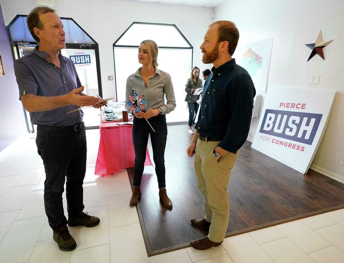 Neil Bush, left, Sarahbeth Bush, and her husband, Pierce Bush, a Republican candidate for the 22nd Congressional District, right, talk during an event at his campaign headquarters Saturday, Jan. 18, 2020, in Sugar Land. Neil Bush is the son of former President George H. W. Bush and Barbara Bush and the father of Pierce Bush.