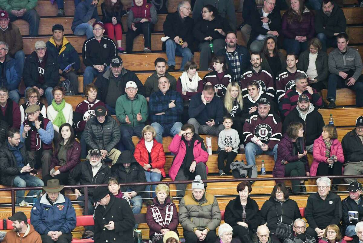 Fans watch Union play Harvard during the second period of an NCAA college hockey game Friday, Jan. 31, 2020, in Schenectady, N.Y.,