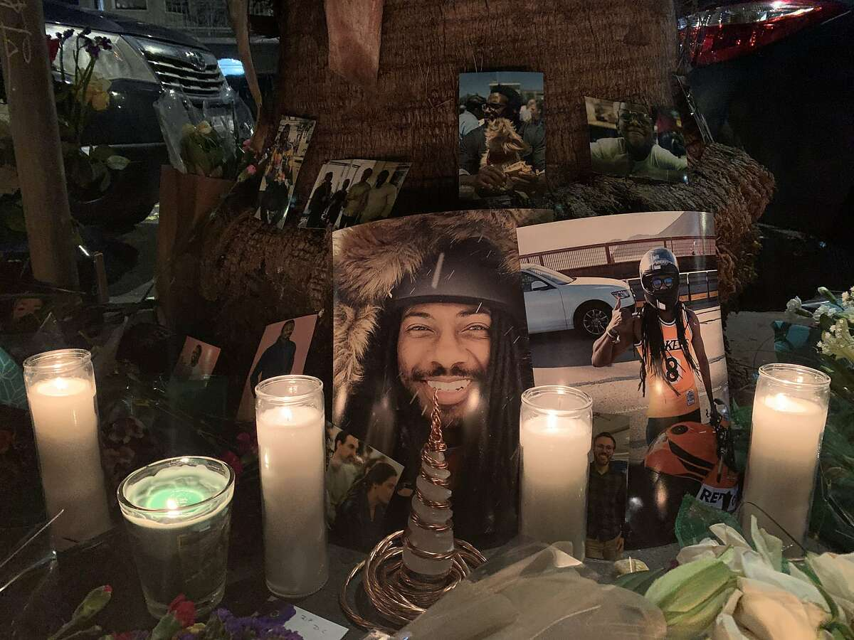 On Thursday, Jan. 30, 2020, dozens of people gathered on Mission Street in San Francisco to honor the life ofDeCarlisWilson, 30, a San Francisco resident who died in a motorcycle crash Sunday afternoon.Photos of Wilson were tacked on the base of a palm tree, surrounded by candles and flowers.