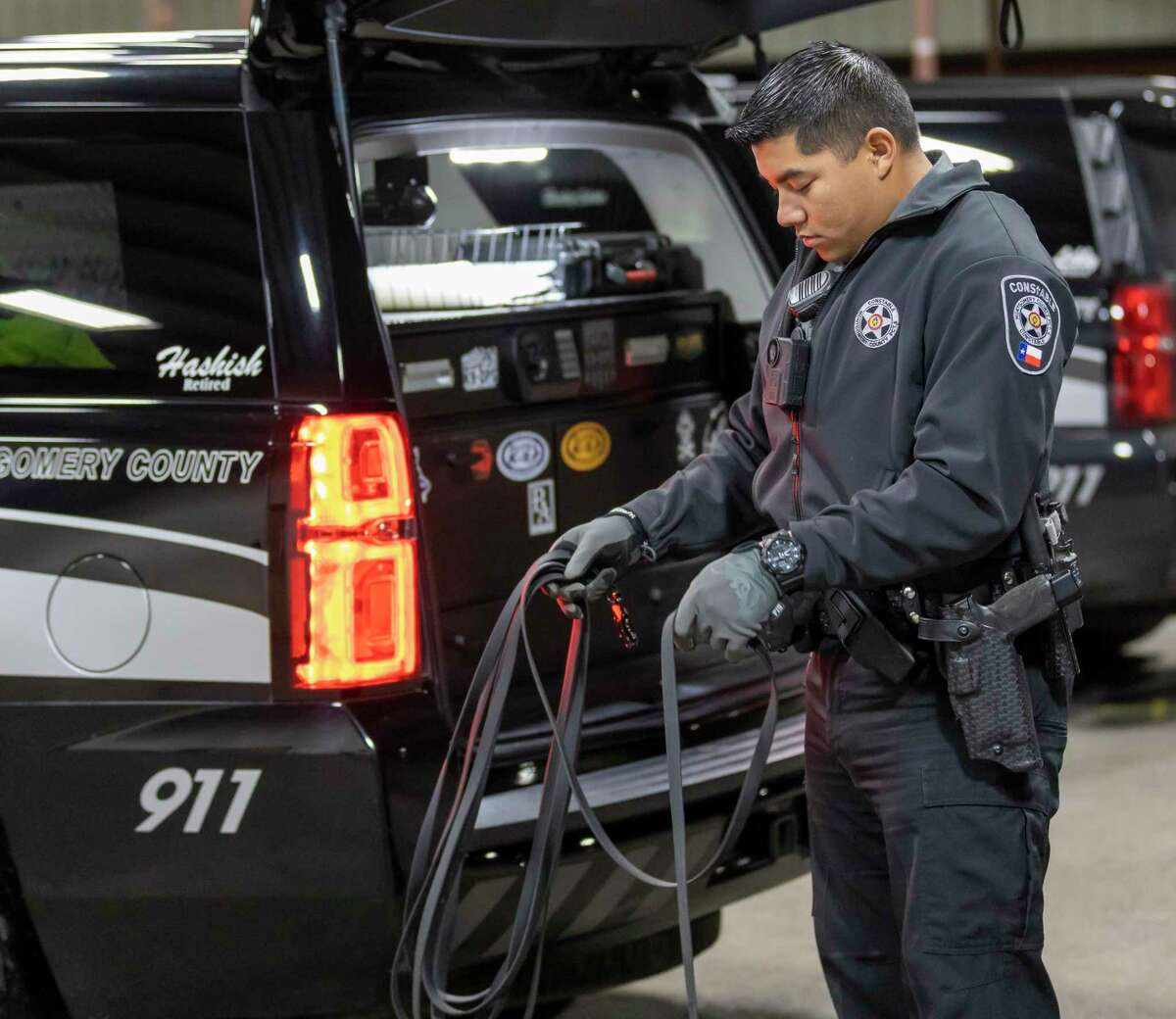 Montgomery County Precinct 4's Constable's K-9 Deputy Rai Duenas prepares a leash for training in New Caney, Wednesday, Jan. 29, 2020.