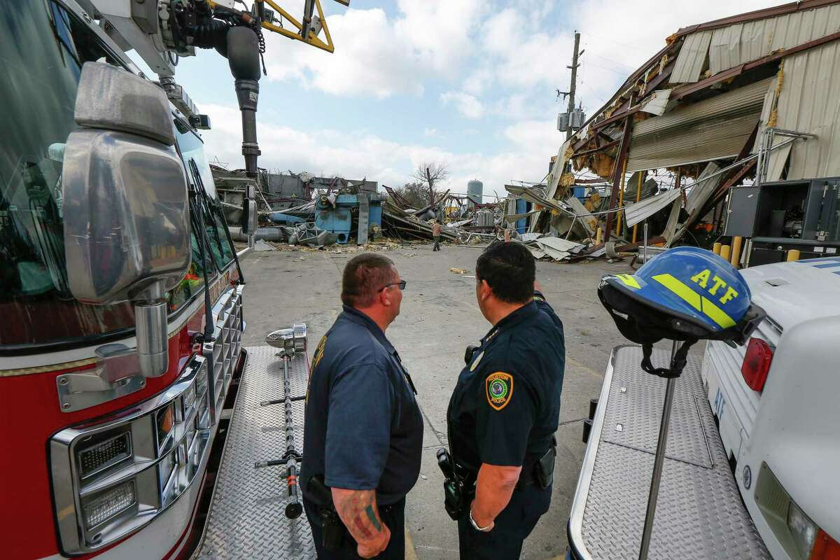 Arson Investigator Anthony Dauphin (left) talks to Houston Police Department Chief Art Acevedo after a press conference on the joint investigation of an explosion at the Watson Grinding and Manufacturing plant Friday, Jan. 31, 2020, in Houston.